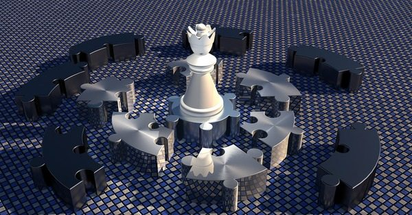 Queen chess piece in a puzzle layout
